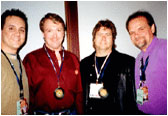 Larry Weir along with his co-editor for New Music Weekly Paul Loggins (left to right) & country artists Phil Calkins & Rick Hertess at the 2002 CRS Convention in Nashville, TN.