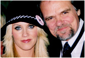 Playboy queen Jenny McCarthy joins Larry at an industry event.